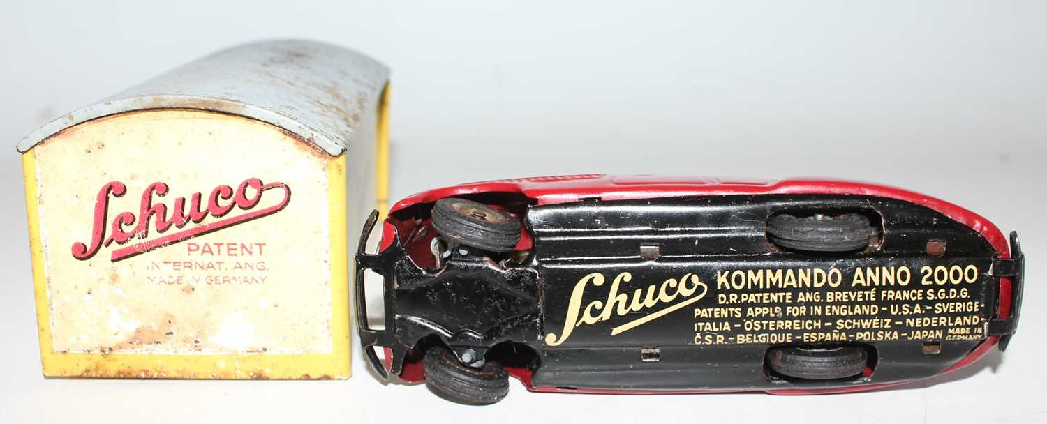 "A Schuco vintage tinplate clockwork car in a garage ""Kommando Anno 2000"" circa mid 40s complete with - Image 4 of 4"