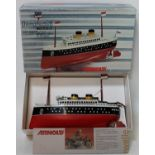 Arnold of West Germany, 87001 (re-issue) tinplate steamer boat, mint in box. (BM)