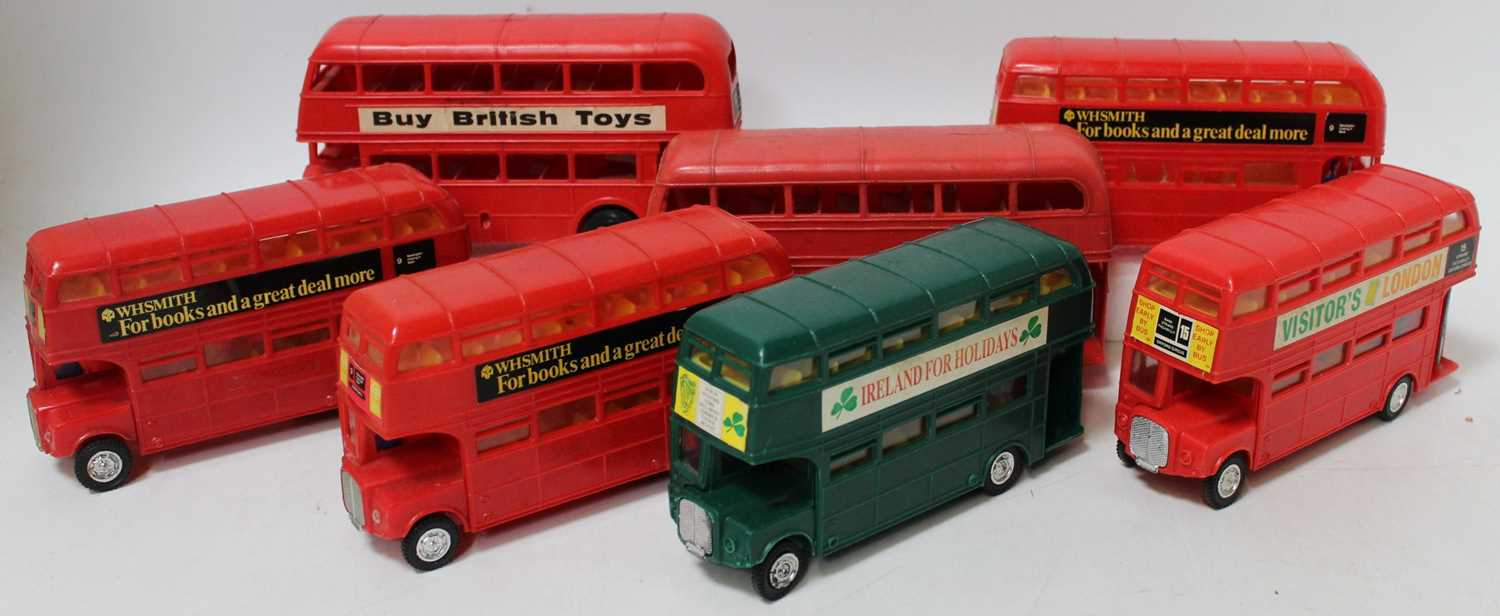 A collection of seven various plastic friction drive and battery operated public transport buses