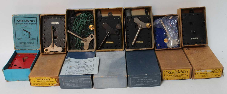 Seven Meccano clockwork motors, all boxed, various eras: 3x No. 1 reversing with 4x No. 1 non