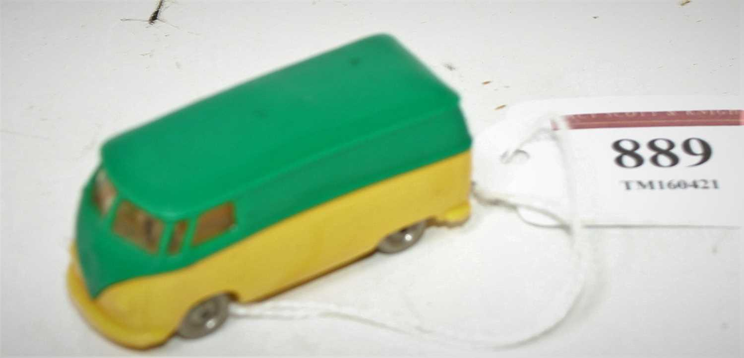 A Vintage Lego plastic model of a VW panel van comprising of green and yellow body with metal