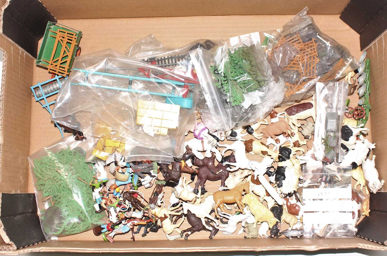 A single owner collection of various Britains floral garden miniatures, mini gift sets and zoo