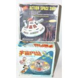 Agroup of two tinplate space themed toys as follows: Masudaya Walt Disney company Mickey mouse