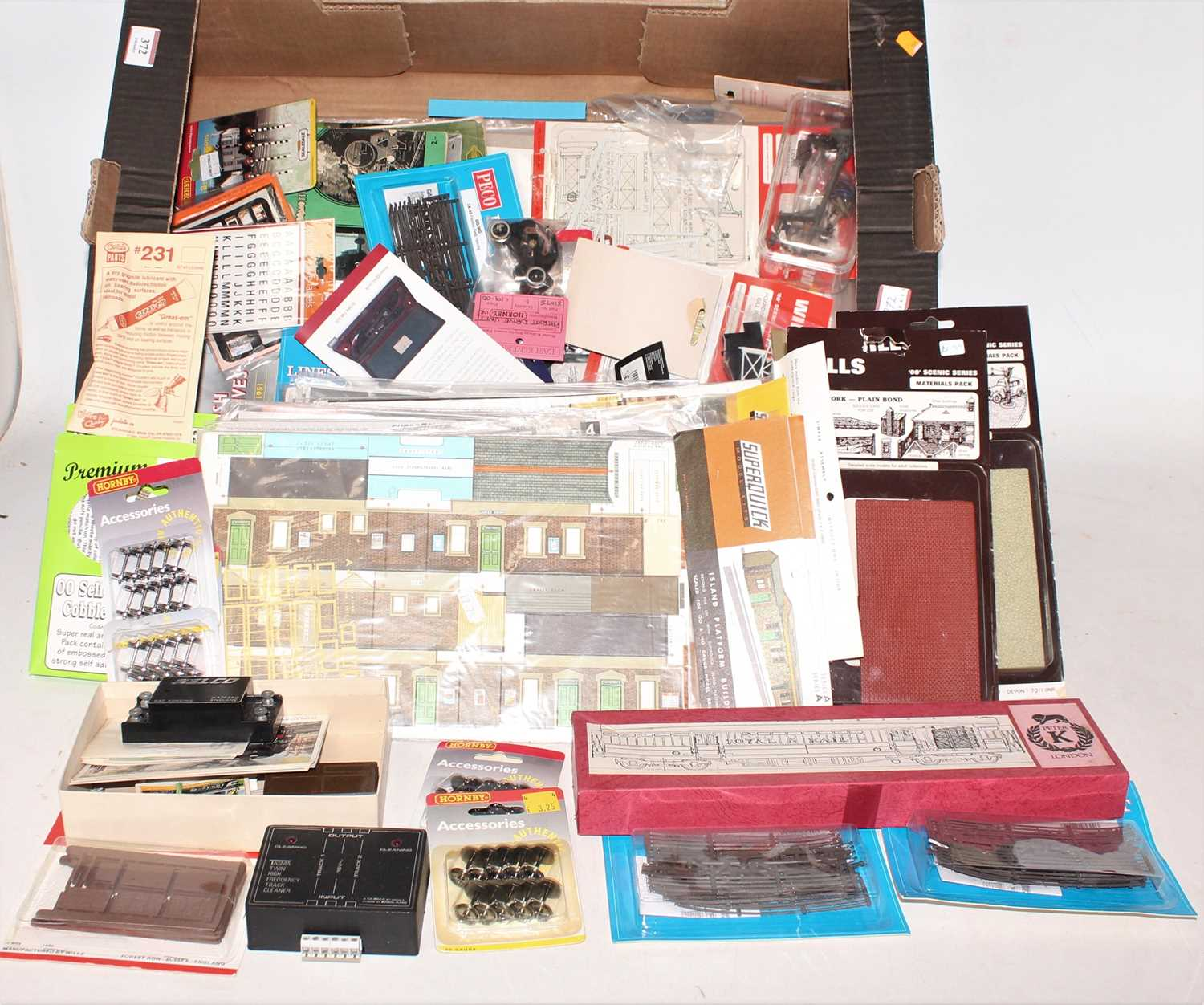 A large tray of 00 Gauge buildings, scenic and lineside accessories, mainly un-opened packets, by