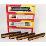 Four various boxed and incorrectly boxed Hornby diesel locomotives and rolling stock to include a