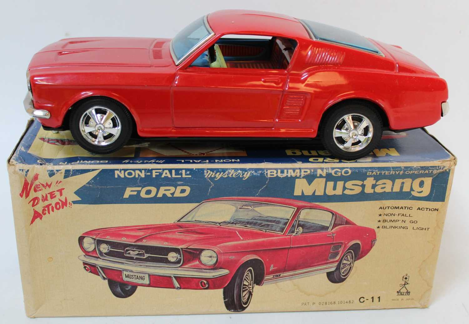 Taiyo Tinplate battery powered Ford Mustang (red) tiny rub mark to roof, very near mint in box. (
