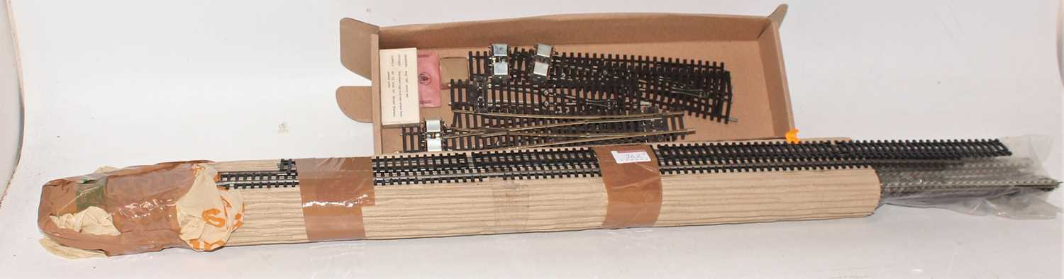 Box of 2-rail track and points, to include 5 Peco Points (4 With Motors), appears to be Triang 3-
