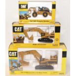 A Norscot Caterpillar 1/50 scale boxed diecast group, three examples to include a Caterpillar 545