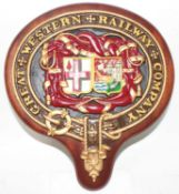 A reproduction Great Western Railway company crest wall plaque, of metal construction housed on