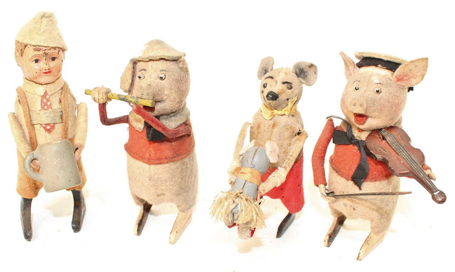 Four various early early 20th century Schuco tinplate and soft covered animals to include pig