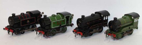 Four Hornby 0-4-0 clockwork locos, 1947-54 No. 101 LNER 460 tank, some marks (G), 1954-60 type 40 BR