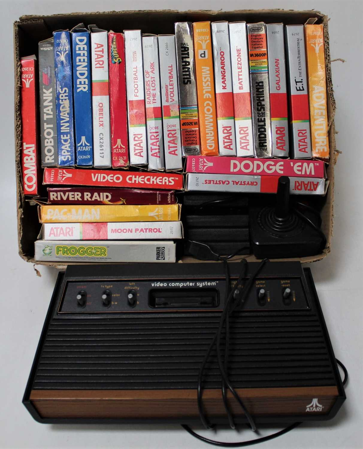 An Atari Video Computer System comprising of console with 28 various games, also sold with control