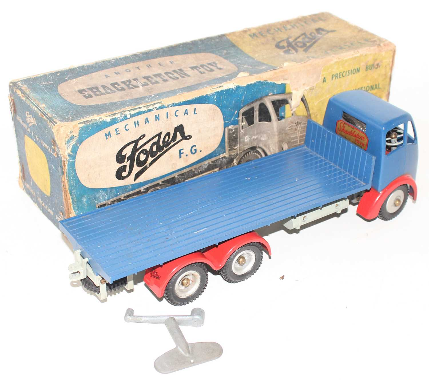 A Shackleton Toys clockwork model of a Foden FG flat bed truck comprising of dark blue cab and - Image 2 of 2