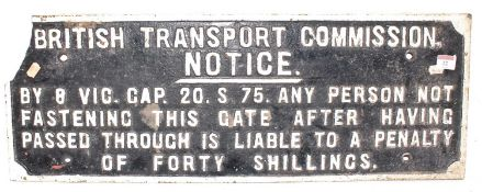 A British Transport Commission cast iron notice stating ''Any person not fastening this gate after