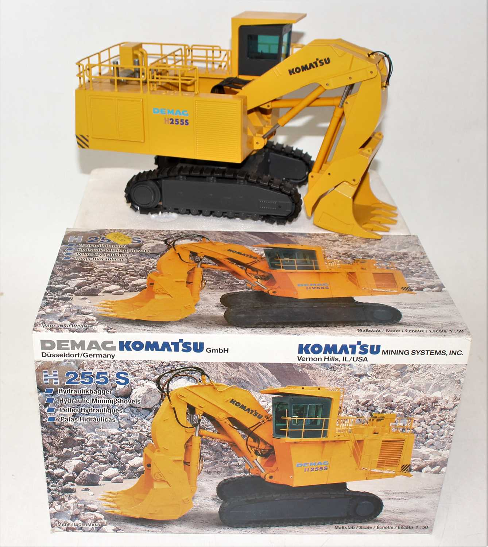 An NZG model No.442 1/50 scale boxed diecast model of a Demag Komatsu H255S hydraulic mining
