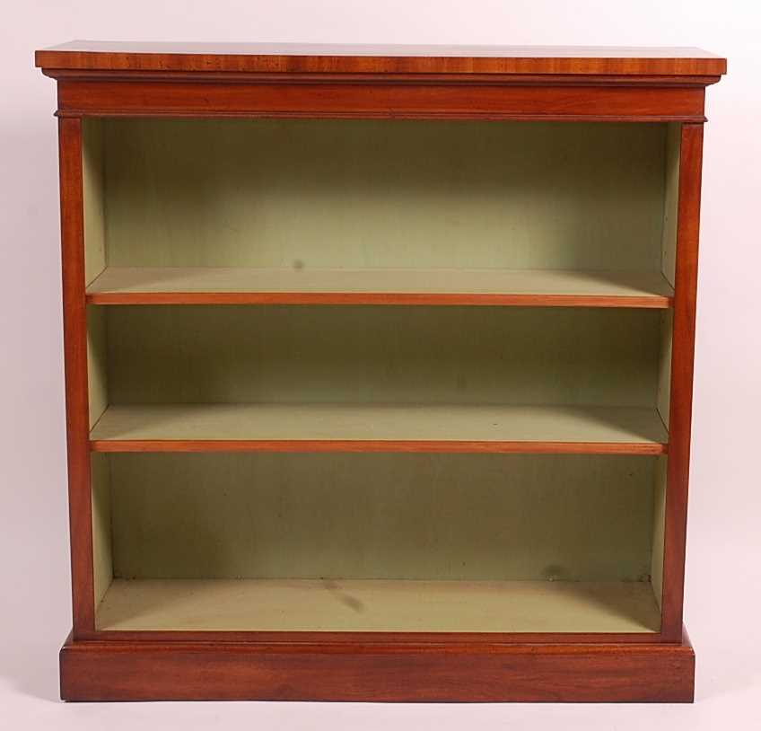 A mahogany freestanding open bookshelf, in the Victorian style, having a crossbanded and inlaid