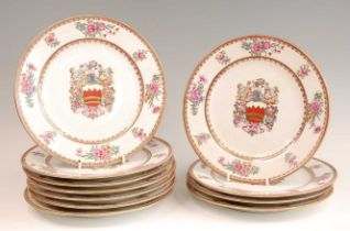 A set of eleven continental porcelain armorial plates, probably Paris, decorated in bright enamels
