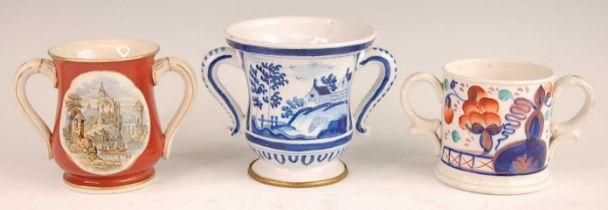 A Victorian prattware loving cup, the reserves decorated with opposing classical continental