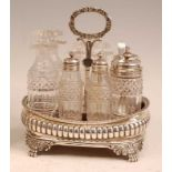 A George III silver eight-bottle cruet, of reeded oval bombe form, with gadrooned rim and lion paw
