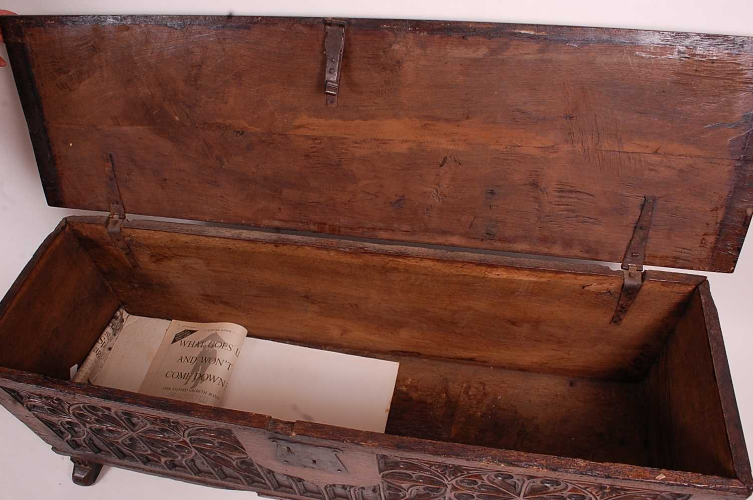 An antique joined and heavy planked oak blanket chest, having Gothic Revival relief carved front - Image 2 of 3