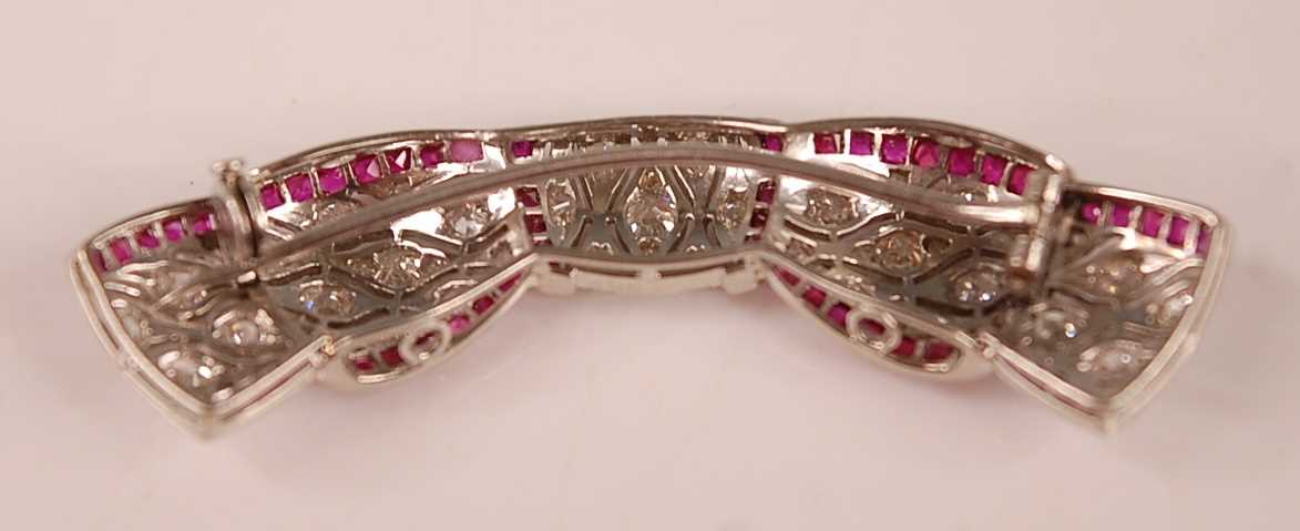An Art Deco style white metal, ruby and diamond swag shaped bar brooch, comprising 81 Old European - Image 2 of 3