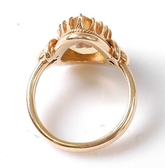 A yellow metal citrine dress ring, featuring a pear cut citrine in a claw setting, with stirrup - Image 3 of 6
