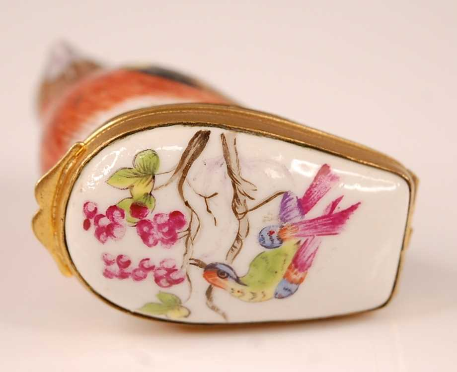 A 19th century porcelain bonbonniere in the form of a bird upon a grassy mound, the bird decorated - Image 2 of 4
