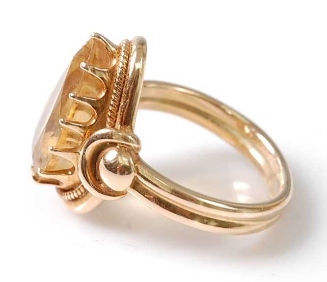 A yellow metal citrine dress ring, featuring a pear cut citrine in a claw setting, with stirrup - Image 6 of 6