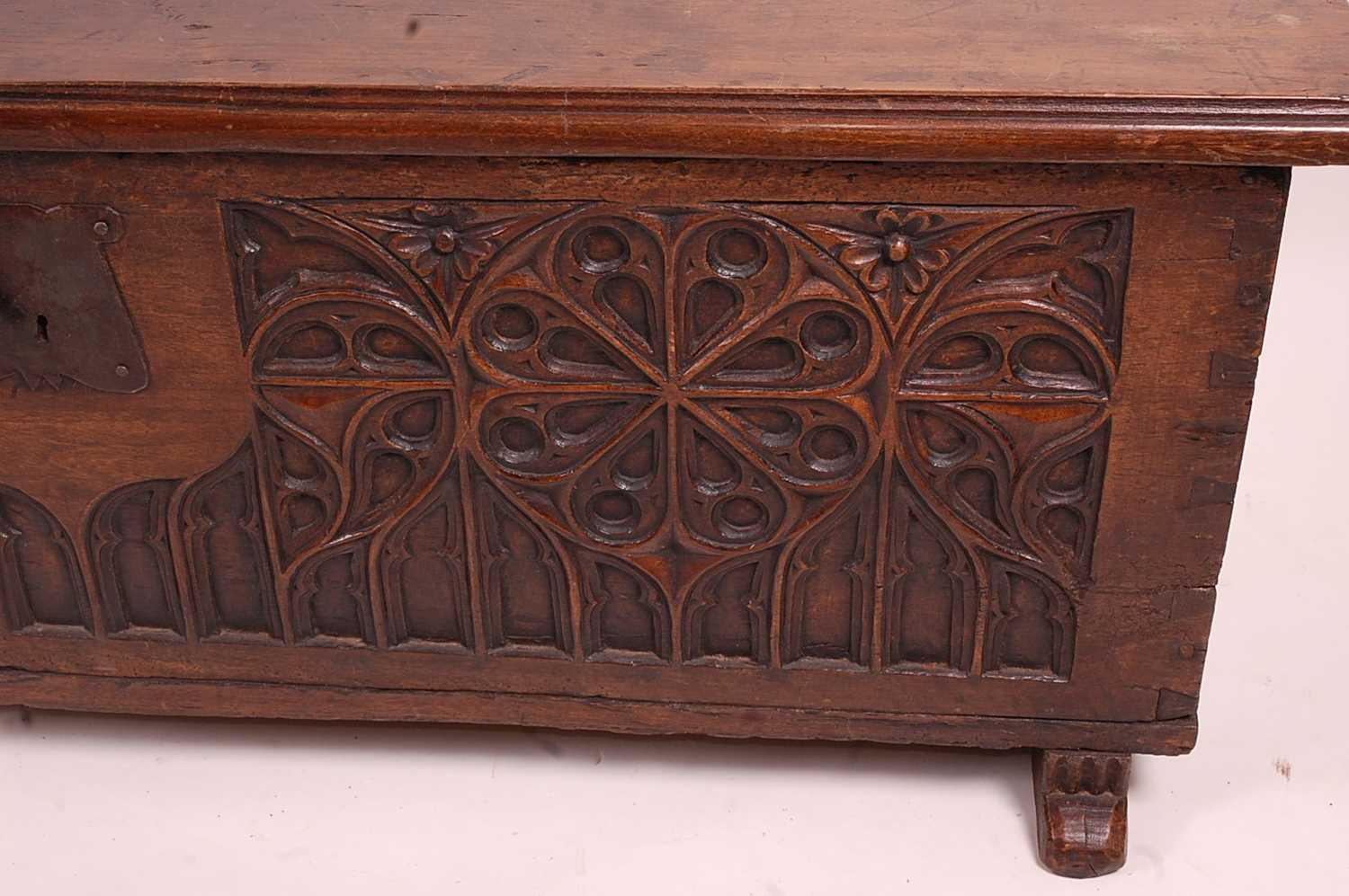 An antique joined and heavy planked oak blanket chest, having Gothic Revival relief carved front - Image 3 of 3