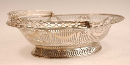 A George III silver basket, of beaded oval form, having swing carry handle, the pierced frieze