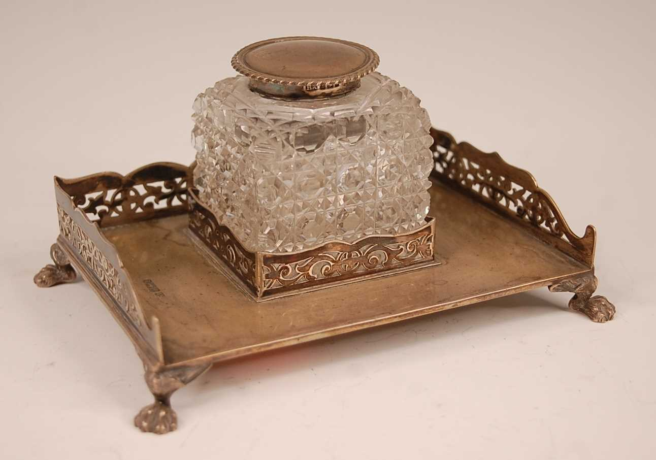 An Edwardian silver desk stand, having a pierced three-quarter gallery and hobnail cut glass