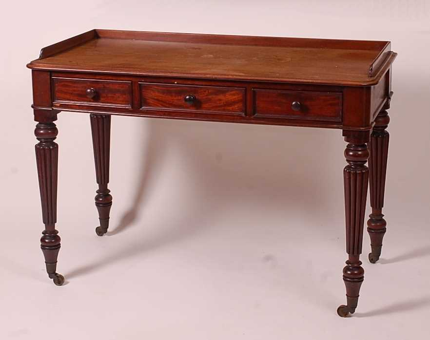 A Victorian mahogany side table by T. Willson of Great Queen Street, London, stamped to the frieze