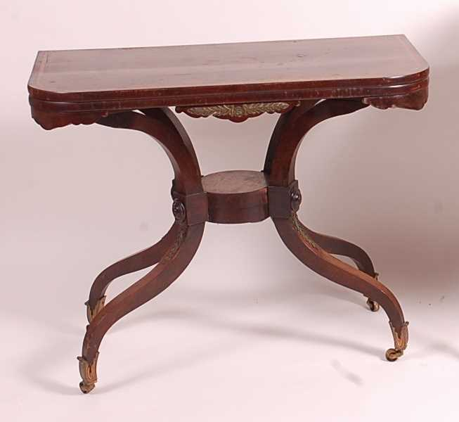 A Regency rosewood pedestal tea table, the fold-over and satinwood crossbanded top on unusual