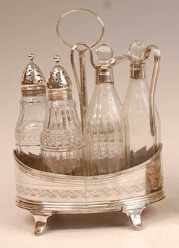 A George III silver five-bottle cruet, of oval form, with bright cut engraved decoration, comprising - Image 2 of 4