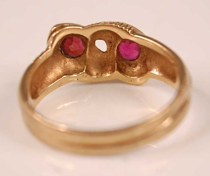 A 9ct yellow gold double-headed intertwining snake's head ring, each head set with an oval faceted - Image 4 of 4