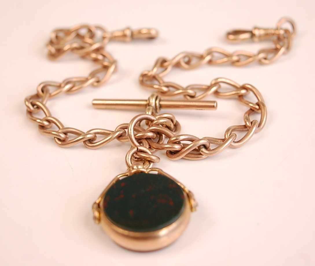A 9ct gold oval curblink watch chain, having T bar and 9ct gold mounted agate and bloodstone