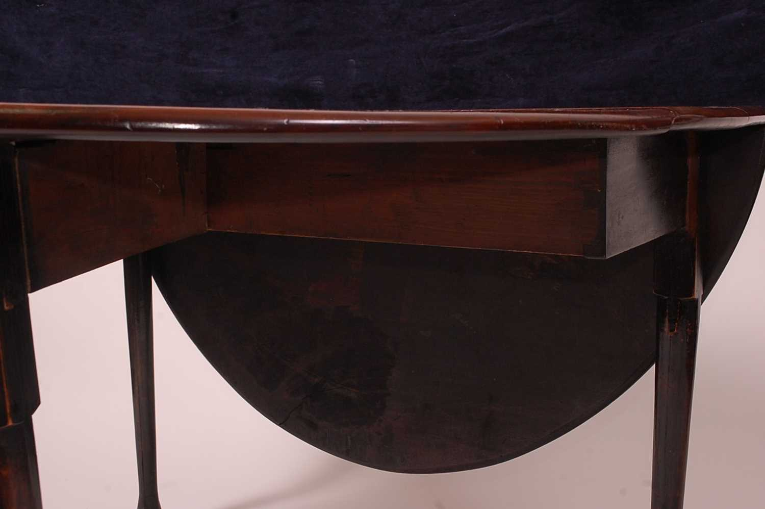 A George III mahogany padfoot dining table, the oval leaves on gatelegs, w.110cm, d.141cm, h. - Image 3 of 5