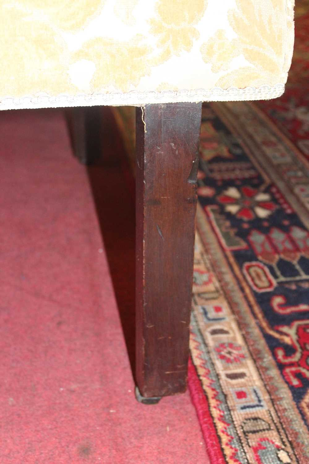 A George III mahogany framed window seat, of serpentine outline, having an upholstered top with - Image 10 of 18