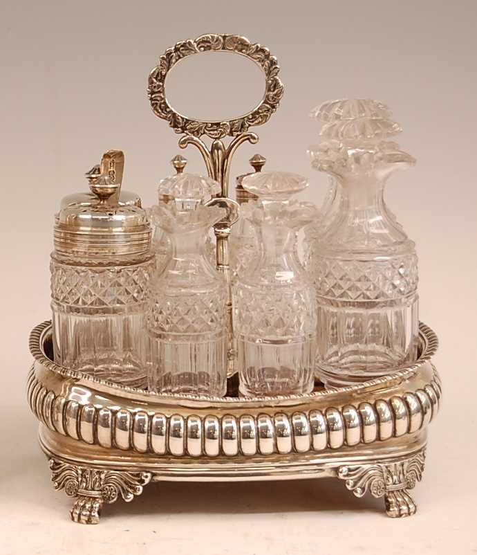 A George III silver eight-bottle cruet, of reeded oval bombe form, with gadrooned rim and lion paw - Image 2 of 4