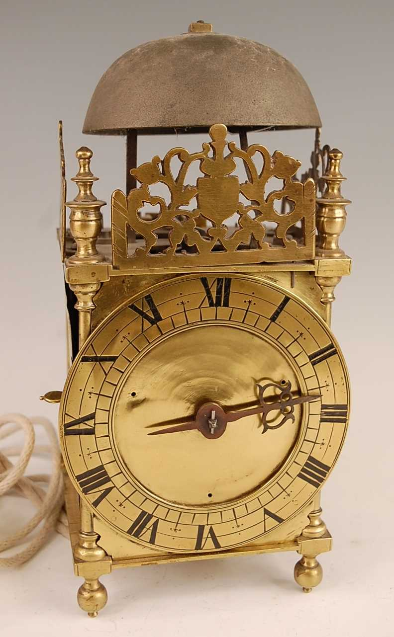 A Victorian brass lantern clock, having a fret-cut gallery over brass Roman chapter ring, single