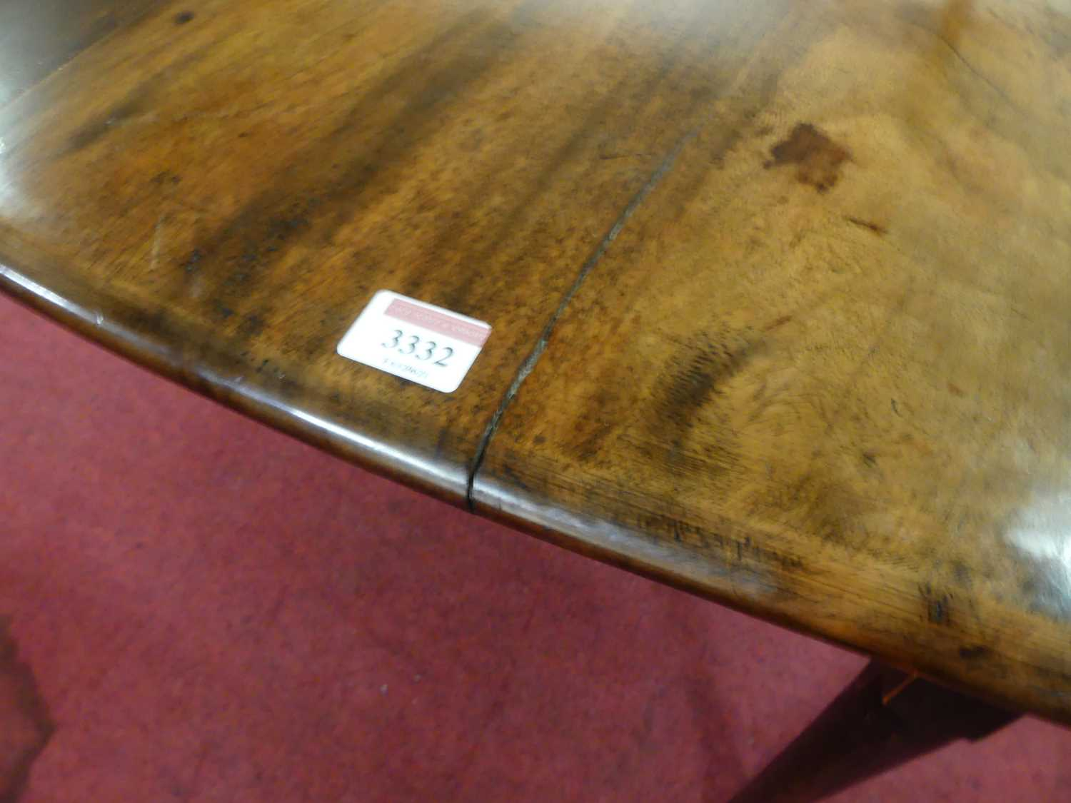 A George III mahogany padfoot dining table, the oval leaves on gatelegs, w.110cm, d.141cm, h. - Image 4 of 5