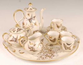 A circa 1900 continental porcelain part coffee service on cabaret tray, comprising coffee pot,