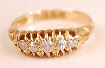 An 18ct yellow gold diamond five-stone half hoop eternity ring, comprising five graduated Old