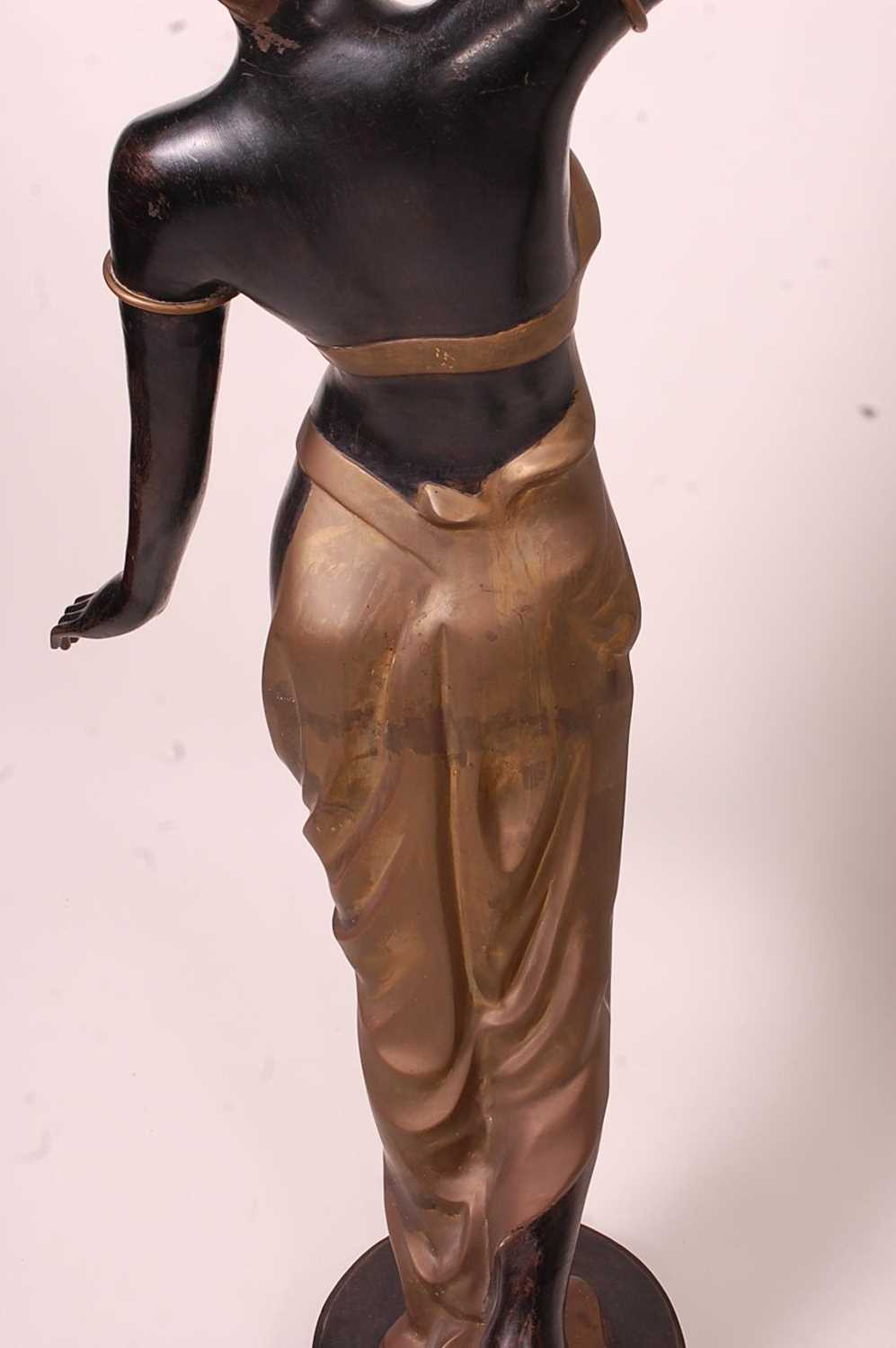 A pair of bronzed metal figurines of maidens, each holding aloft a flaming torch, in black and gilt, - Image 9 of 9