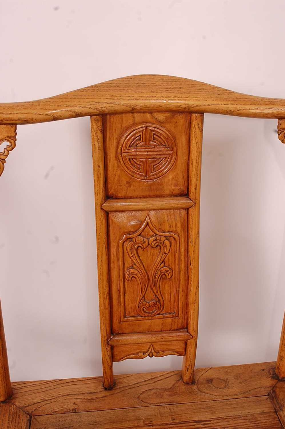 A pair of Chinese 'elm' elbow chairs, having carved splat yoke backs - Image 2 of 5