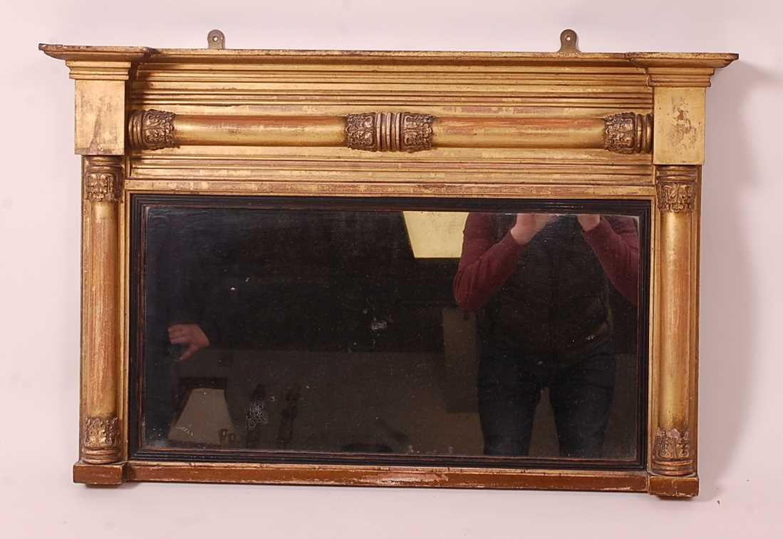 A Victorian giltwood and gesso chimney mirror, having acanthus leaf capped plain pilasters, 55 x