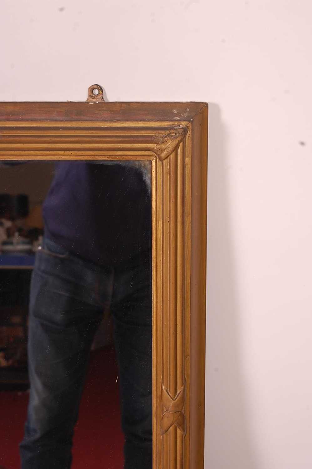 A 19th century giltwood and composition wall mirror, the rectangular plate within a proud reeded - Image 3 of 5