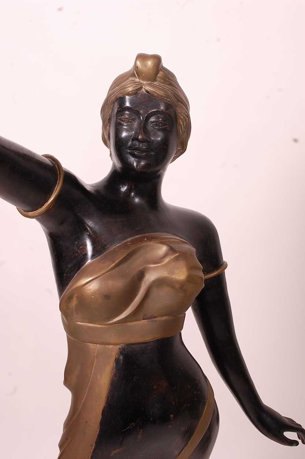 A pair of bronzed metal figurines of maidens, each holding aloft a flaming torch, in black and gilt, - Image 5 of 9