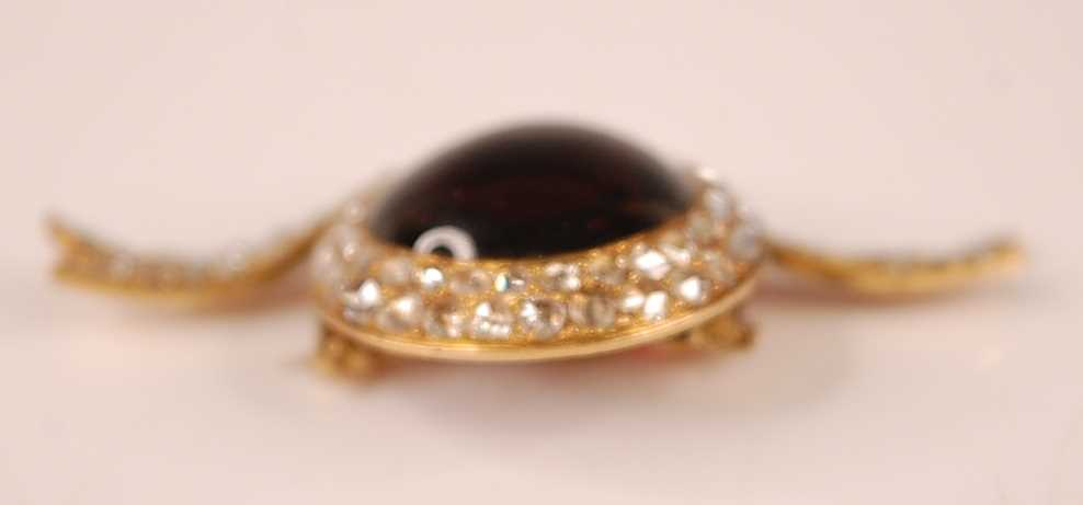 An early 20th century yellow metal bar brooch in the form of a be-ribboned hat, featuring a centre - Image 3 of 4
