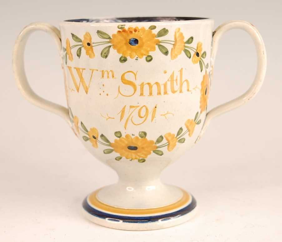 A George III pearlware pedestal loving cup, the bell shaped bowl inscribed William Smith and dated